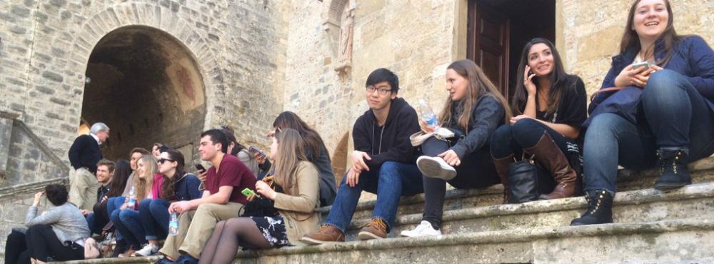 Students sitting on stone steps.